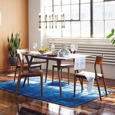 Dining room - stone wall color, modern accents (mother in laws tongue, floor stand vases, etc) Mid-Century Expandable Dining Table #westelm