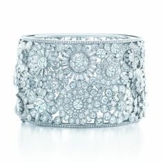 A bangle of round and baguette diamonds from the 2013 Tiffany Blue Book.
