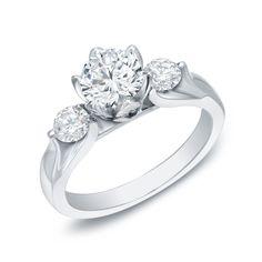 <li>Round-cut white diamond engagement ring</li><li>14-karat white gold jewelry</li><li><a href='http://www.overstock.com/downloads/pdf/2010_RingSizing.pdf'><span class='links'>Click here for ring sizing guide</span></a></li>