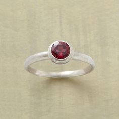 FIERY DEPTHS GARNET RING--Internal facets light up the depths of a round, deep pink garnet. Handmade in matte sterling silver with a hammered band. Whole and half sizes 5 to 9.