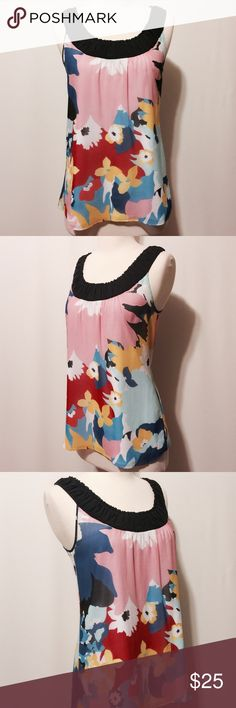 ✨ Kensie Colorful Silk Print Top Playful and bright! Primary colors in a fun floral print framed in black. 100% silk - body 100% poly - lining Hand wash Kensie Tops Blouses