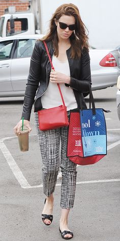 Mandy Moore looks chic while grabbing a juice in printed pants and red cross-body purse