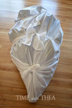 Use drop cloths to create bags for the top, middle, and bottom pieces of your artificial Christmas tree. Then you can store them in your garage all year long without worrying about them getting flat or dirty.