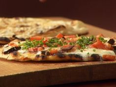 Grilled Pizzettas with Parmigiano, Prosciutto and Arugula and with Taleggio and Puttanesca Recipe : Anne Burrell : Food Network - FoodNetwork.com