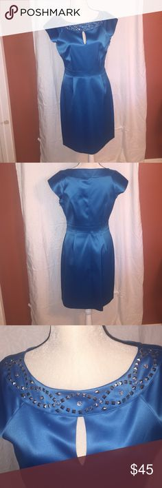 Elegant Dress💄👠💋🍷 Beautiful embellished neck line. Cap sleeves with side zipper. Color is a shiny turquoise blue. Never worn 👗👗 Laundry by Design Dresses