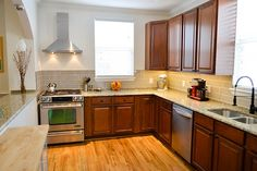AT Kitchen Remodel - love the cherry cabinets, oak floor, and subway tile back splash. (more pics on Flickr) - J