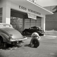 "September 1940. Washington, D.C. ""Service station on Connecticut Avenue."" ""Tires on Credit""...my oh my, have times changed. @A Lifetime Legacy"