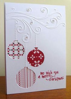 handmade Christmas card ... white with red ... trio of negative space baubles backed in printed papers ...