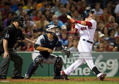 Andrew Benintendi #40 of the Boston Red Sox hits an RBI double against the New York Yankees in the fifth inning on August 9, 2016 at Fenway Park in Boston, Massachusetts.