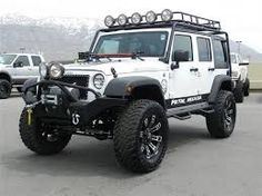 White JK Unlimited With Larger Wheels/tires, Custom Bumpers, Side Rails And  Roof. Roof RackJeep Wrangler ...