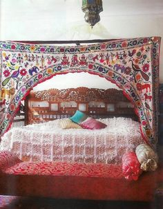 Love this Indian wedding doorway canopy mixed with Moroccan wedding blanket.  Someday... when all the rooms in my house have themes