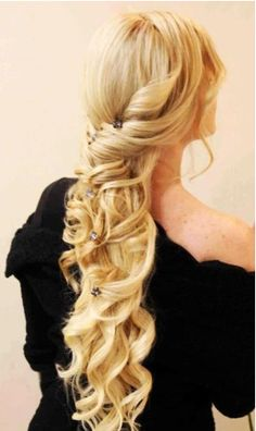 Hairstyle that looks like something a medieval princess would have worn. Created using hair extensions.
