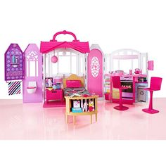 If your child is genuinely interested in Barbie dolls, she's going to want a house specifically made for her Barbie collection. Go ahead and choose the Best Barbie House Mattel Barbie, Barbie Dolls, Barbie Sets, Mattel Shop, Barbie Games, Baby Barbie, Accessoires Barbie, Pink Chandelier, Glam House