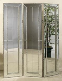 From HomeDecorators.com Standing mirrored Room Divider $699.00