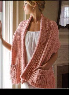 beautiful crochet shawl with pockets. Would be great to carry in car for trips to chilly grocery stores.