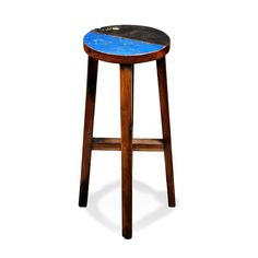 Made from reclaimed wood this backless stool features a colorful comfortable seat with a simple yet versatile design that fits almost any style home.