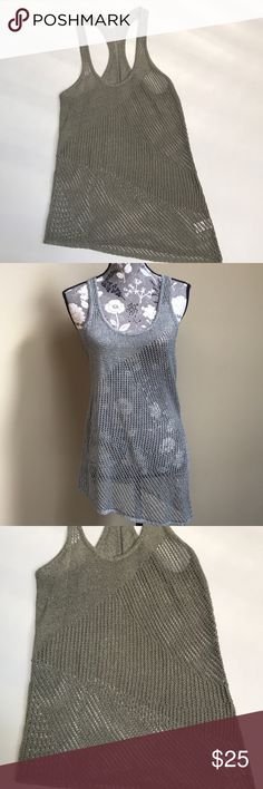 "Helmut Lang Sleeveless Asymmetrical Tank Beautiful Helmut Lang Sleeveless Asymmetrical Racerback Sweater Tank size medium. Excellent preloved condition. 57%linen, 27% cotton and 16% polyester. Taupe/ Gray color. 15.5"" from underarm to underarm and 31.5"" long. Helmut Lang Tops"