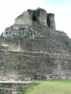 Xunantunich is an Ancient Mayan archaeological site in western Belize, about 80 miles (130 km) west of Belize City, in the Cayo District. Xunantunich is located atop a ridge above the Mopan River, well within sight of the Guatemala border – which is a mere 1 kilometre (0.62 mi) to the west. [1] It served as a Maya civic ceremonial center in the Late and Terminal Classic periods to the Belize Valley region. At this time, when the region was at its' peak, nearly 200,000 people lived in Belize