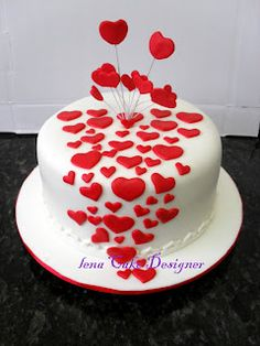 White cake with splattering of red hearts-too cute