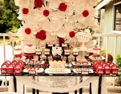 Red and white theme candy buffet.