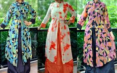 MIRRORS AND PRINTS! Georgette Printed Kurta(with body lining) with mirror work collar and a front slit teamed up with semi rawsilk skirt(no lining) .
