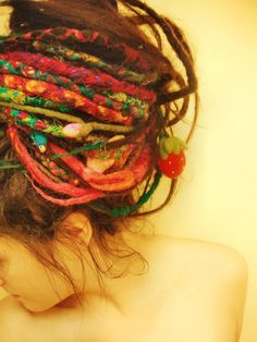 Think the colours are from sewing thread into the dreads so they lock, Would love to have some fun with that.
