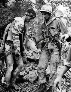 Wounded Soldier in Vietnam click and see other pics of caring.