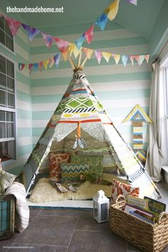 Which kiddo wouldn't love this teepee playroom. stripes and flags