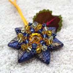 FRESHMOOD FLOWer Collection - Swarovski beads and polymer clay together in a colorful pendant. Made by Zsuzsanna Csapó from Hungary