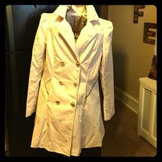 """Classy Women's Fit and Flare Trench Coat This beauty is NWOT.  It's foreign made so it doesn't have tags.  Arrived shrink wrapped (thus the wrinkles).  Material is a sateen feel and shine.  Adorns two side pockets, pleated shoulders, and pleated back and gold tone buttons.  Size says 2X but the cut is very small more like a big M or regular Large.  Measurements 20"""" pit to pit and 18"""" pit to cuff arm length. I purchased for self, and unfortunately, it doesn't accommodate my 38DD bustline…"""