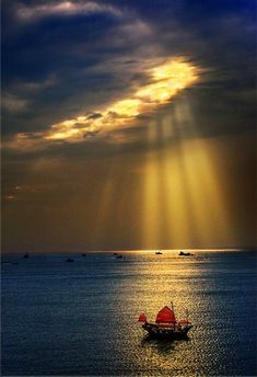 ~~sun rays, red sails and tranquil water by Mayso Leung~~
