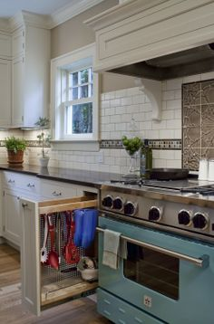This is a great idea for a kitchen.  If you can get a great deal on a colored stove..go for it!