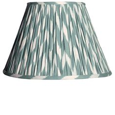 A gathered empire shade in a softly spoken, beautiful zig-zag ikat pattern. We've called it eau-de-nil as green just didn't cut it