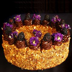 This was my favorite cake when I worked at Extraordinary Desserts in San Diego. Hazelnut buttercream, chocolate mousse, boysenberry preserves and crushed pralines.