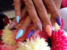 Stiletto nails with different coloured polish and leopard print nail art
