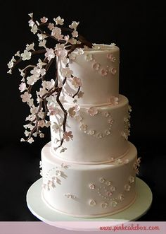 Pink Cherry Blossom Wedding Cake by Pink Cake Box in Denville, NJ.  I like the way they used the flowers to create scroll-work.