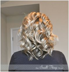 Curling your hair with a flat iron.  Great site for some cute hairstyles for medium to long.