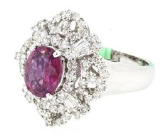 Ring (80) Round and Baguette Diamonds 1.35ct.tw Center Pink Sapphire 2.43ct.tw…