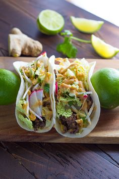 A fast and delicious taco remix! Ground beef is cooked up with ginger and lime, topped with crunchy veggies, and drizzled with a peanut sauce that is to die for! I think by now we've establi…