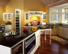 White cabinets, yellow kitchen and hardwood floors!