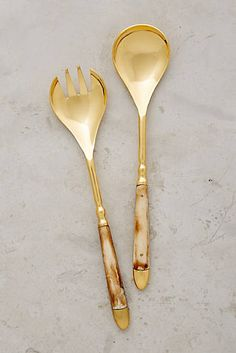 Love this Horn Inlay Serving Set from Anthropologie, with champagne sheen contrasted with a worn texture. Check out Liberty Hardware's bronze collection for metallic details to tie together a golden kitchen theme.
