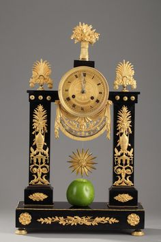 Figural mantel clock in sculpted gilt bronze featuring a young woman wearing a flowing stola. The clock casing is embellished with ovals and foliage. The clock face is bordered with. Antique Clocks For Sale, Antique Mantel Clocks, Antique Stores, Luis Xvi, Empire Furniture, Classic Clocks, Unusual Clocks, Art Ancien, Pendulum Clock