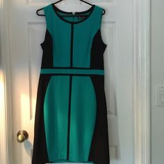 Teal and black sheath dress Teal and black, worn once , great condition and size 8 New York & Company Dresses Asymmetrical