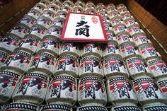 Donating casks of sake, such as these arranged beside the Sensoji temple in Tokyo's Asakusa district, is another New Year's tradition. Hundreds of casks can be found arrayed at the most popular temples, often with a placard nearby naming the donor. These casks come directly from the sake firm Ozeki. During ceremonies the casks are smashed open with a mallet and the contents served to all. (Photo and caption by Louis Templado)