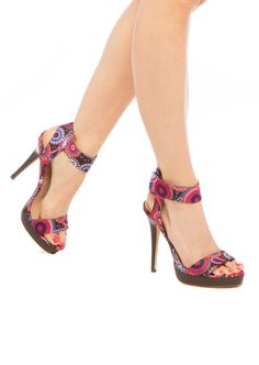 Show off the pretty print on this faux-stacked platform heel by pairing it with anything cuffed or short-hemmed.