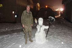 Think our deployed troops don't need/want scarves and hats for the cold winter months? Think again! Here's a photo from this past winter... Caption: Major Greg Majewski stands next to a snowman near his military building in Kabul, Afghanistan. (Photo Credit: Major Greg Majewski)