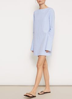 <p>A crisp cotton piece in a blue and white check seersucker. Wear as a mini dress with sandals for your next getaway, or fold it as a top paired with your favorite denim for a relaxed daytime look.</p>