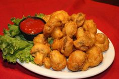 Deep Fried Mushrooms with cocktail sauce.