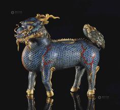 China, 18th Century A CLOISONNÉ ENAMEL AND GILT-BRONZE QILIN CENSER AND COVER