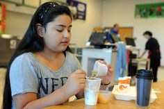 """Sixth grader Jade Quinones, 11, mixes granola and yogurt during breakfast Sept. 18 at Skyview Middle School in Falcon School District 49. The school's successful breakfast program is a big reason why it received a $2,500 Colorado Healthy School Champions award this year, according to Tony Marino, physical education teacher. """"We're evaluating how this money will be best used to impact our children,"""" said Marino, who leads the coordinated school health team at Skyview Middle School."""